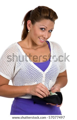 Woman about to make a purchase, reaches into her purse to take out her money. - stock photo