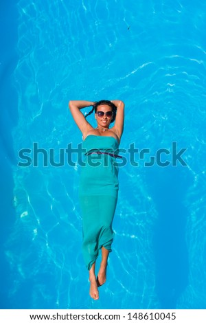 Woman above swimming pool water