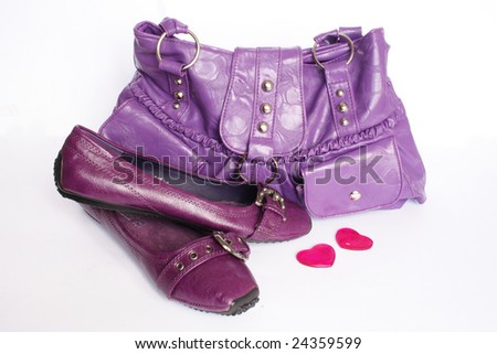 Woman accesories and hearts on white background - stock photo