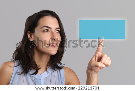 Woman activating a blank rectangular navigation button with copyspace for your text on a virtual touch screen or interface with her finger in a concept of smart technology, access and connectivity - stock photo
