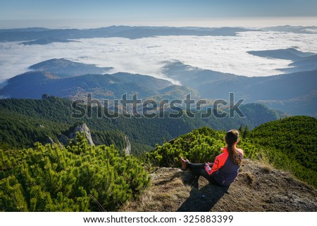 Woman admiring the view in the mountains of Romania