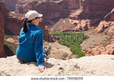 Woman Admiring View of a Canyon - stock photo