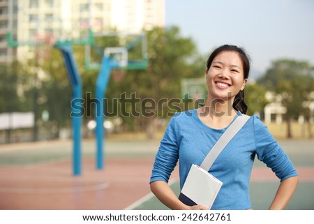 woman adult student in college  - stock photo