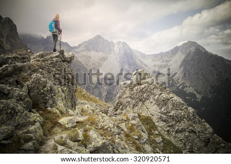 woman adventure hiker on mountain summit - stock photo