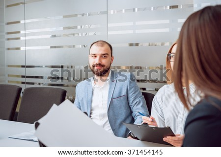 Woman adviser with a businessman. In the office
