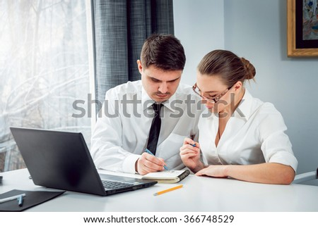 Woman adviser with a businessman. Working in the office