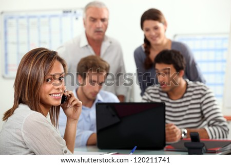 woman advising a group  of people possibly a family - stock photo