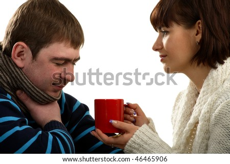 Woman allows to drink a medical drink to the ill man - stock photo