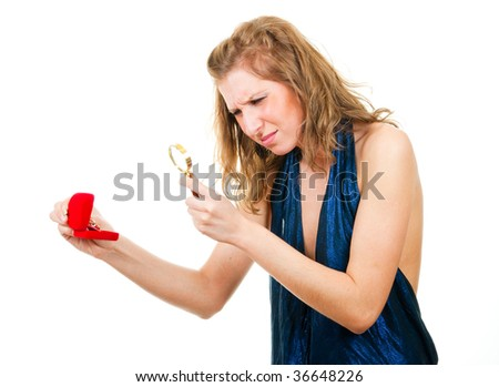 Woman analyzes a ring in red box through magnifier, isolated over white