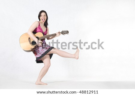 Woman and acoustic guitar