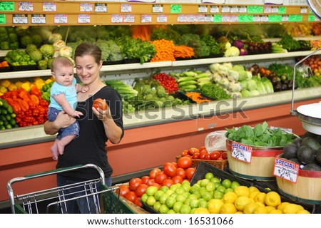 Woman and baby in grocery store - stock photo