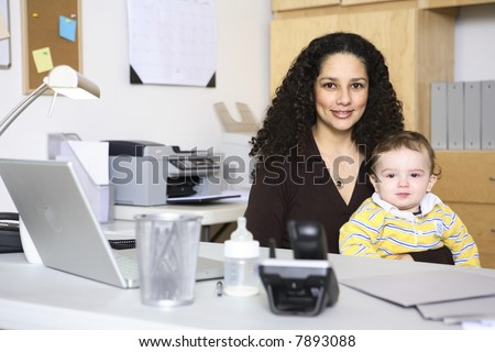 Woman and baby in home office - stock photo