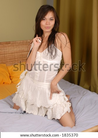 woman and bed - stock photo