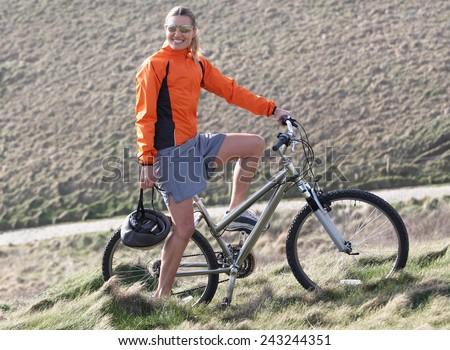 woman and bicycle - stock photo