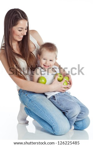 Woman and boy apples - stock photo