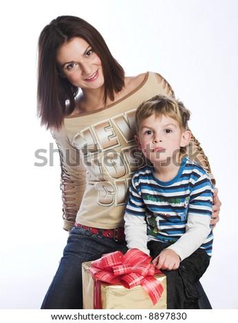 Woman and boy checking christmas presents - stock photo