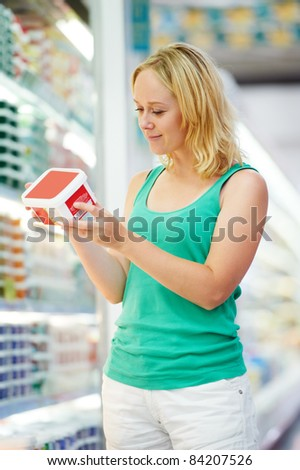 woman and boy choosing produces in grocery shopping mall - stock photo