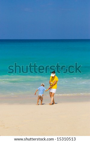 woman and boy playing in caribbean beach