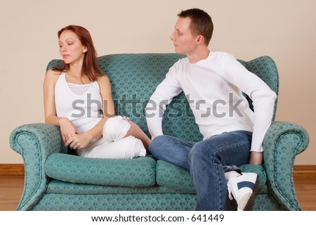 Woman and boyfriend sitting on couch