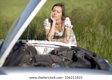 Woman and broken car - stock photo