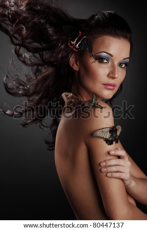 woman and butterfly - stock photo