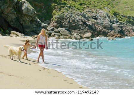 woman and child having fun on the beach