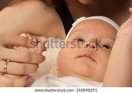 Woman and Child. Kid playing isolated portrait. Young mother girl. Young mother hugging baby. Young mother hugging baby - stock photo