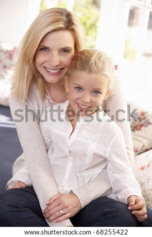 Woman and child pose in studio - stock photo