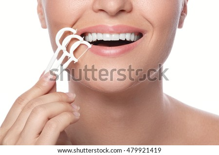 Woman and dental floss pick on white background