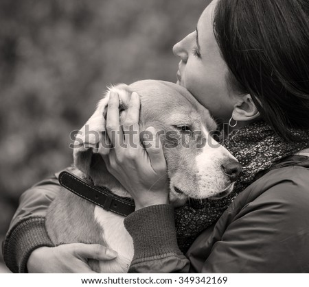 Woman and dog tender hugs - stock photo