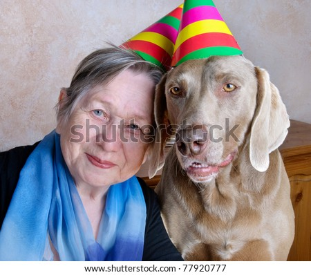 woman and dog with party hats - stock photo