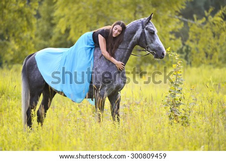 Woman and grey horse - stock photo