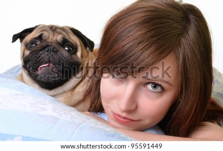 Woman and her dog  in the bed