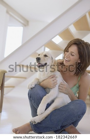 Woman  and her dog in the house - stock photo