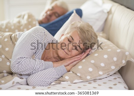 Woman and her husband sleeping comfortably