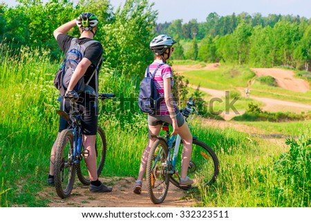 woman and her husband were on bikes on the mountain - stock photo