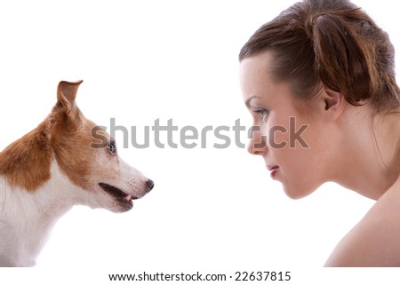 Woman and her jack russel terrier staring at eachother - stock photo