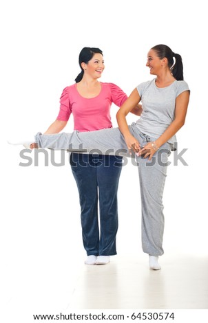 Woman and her personal trainer laughing together at gym