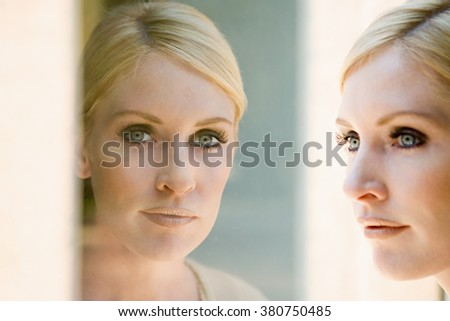 Woman and her reflection - stock photo