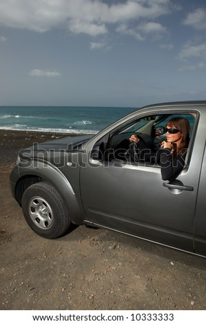 Woman and her 4wd car at beach