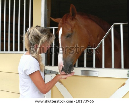 Woman and horse in gentle, trusting relationship
