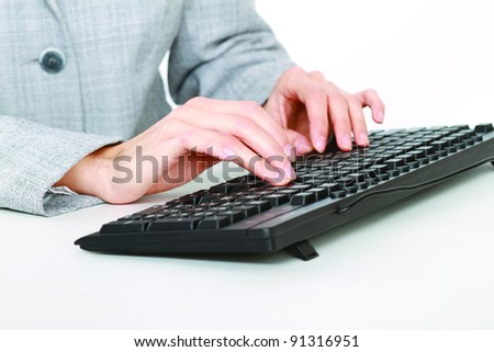 woman and keyboard in the office