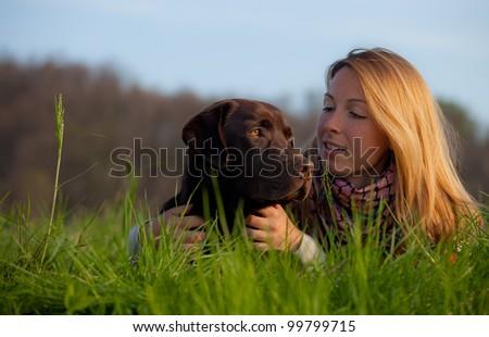 woman and labrador dog - stock photo