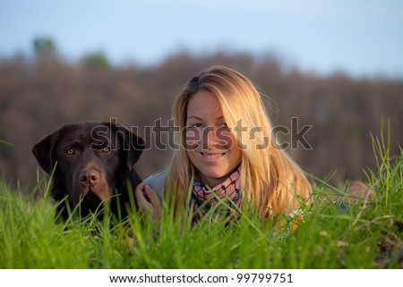 woman and labrador dog