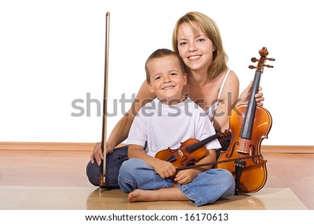 Woman and little boy sitting on the floor with violins - isolated