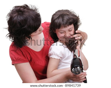 woman and Little girl dries hair, daughter isolated on white - stock photo