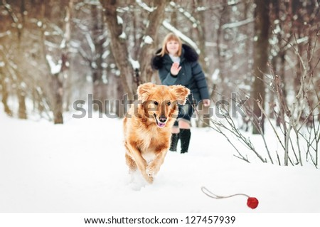 Woman and lovely golden retriever - stock photo