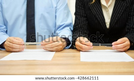 Woman and man are reading agreement on meeting - stock photo