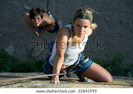 Woman and man engage in extreme sports - stock photo