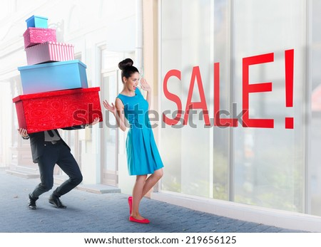 Woman and man going shopping downtown  - stock photo